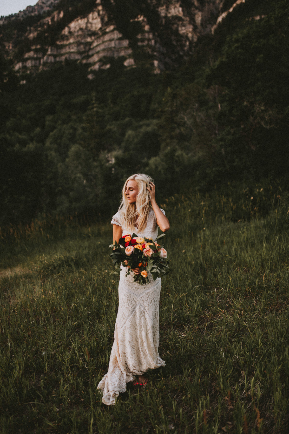 adelaide-lace-bohemian-wedding-dress-shown-with-bouquet