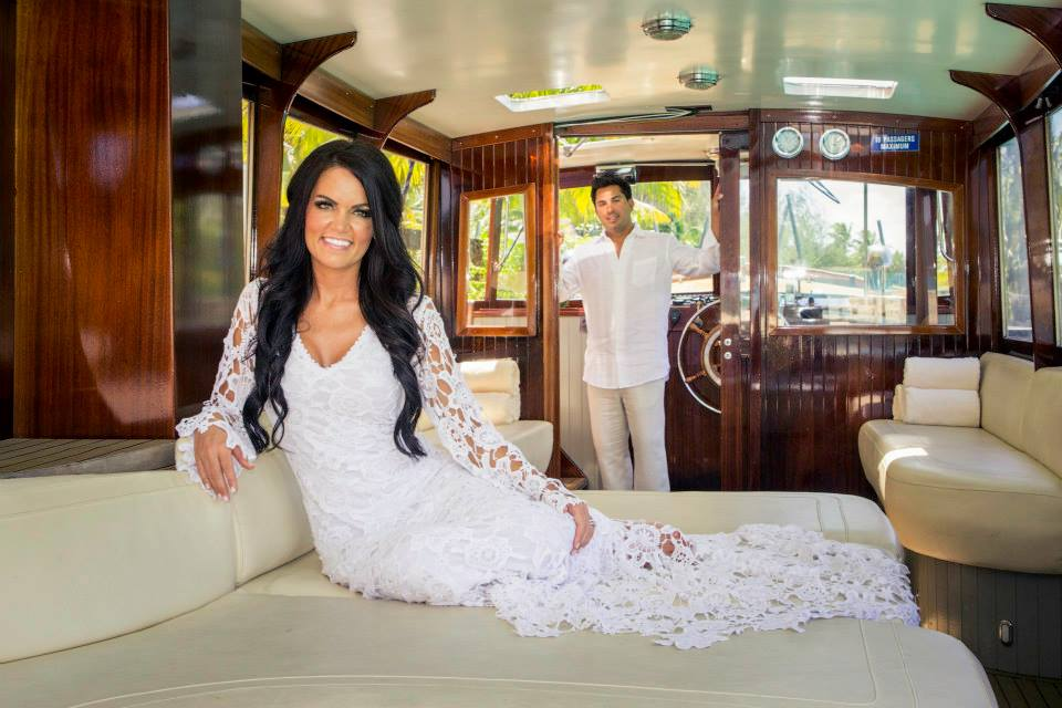 bohemian-bride-and-groom-in-white-crochet-boho-wedding-gown-with-train-on-the-beacg