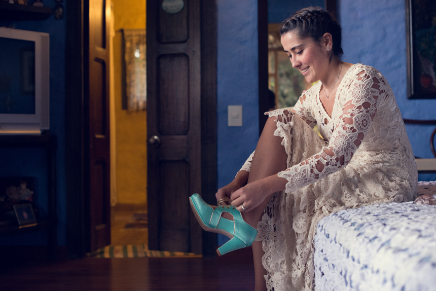 Amalia-wearing-isis-bohemian-wedding-dress-and-blue-vintage-shoes