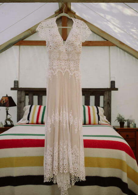 a-brides-bohemian-wedding-dress-hanging-inside-the-canvas-rtent-before-her-wilderness-wedding
