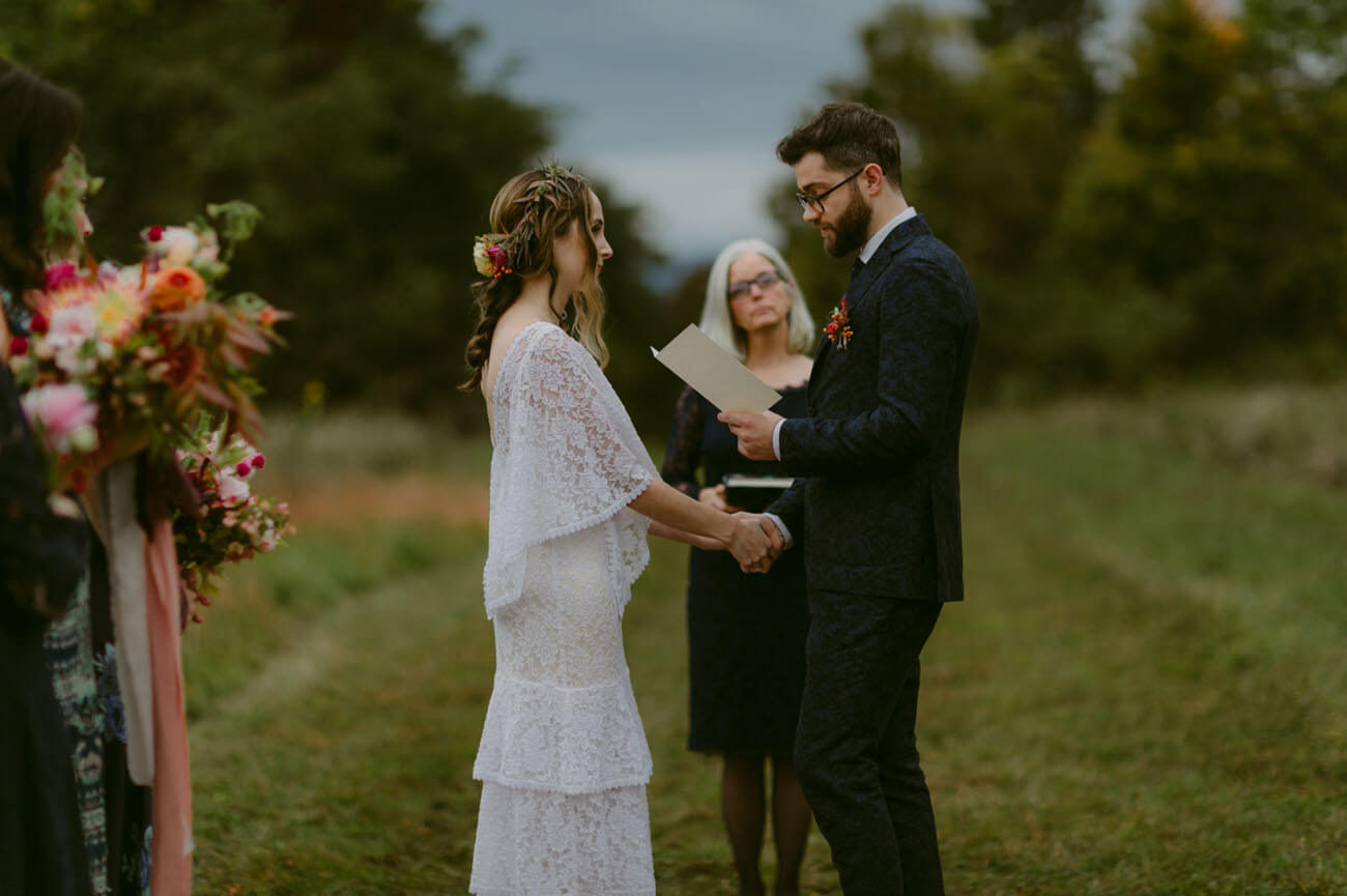 a-laidback-bride-in-white-lace-dress-for-her-small-casual-boho-wedding