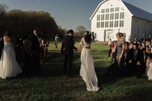 a-laidback-boho-bride-and-groom-at-their-barn-wedding-she-wears-two-piece-silk-lace-wedding-dress