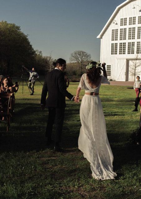 a-laidback-boho-bride-and-groom-at-their-barn-wedding-she-wears-two-piece-silk-lace-wedding-dress
