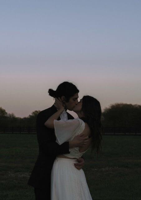 bride-and-groom-shares-kiss-bohemian-wedding-dresses-inspiration