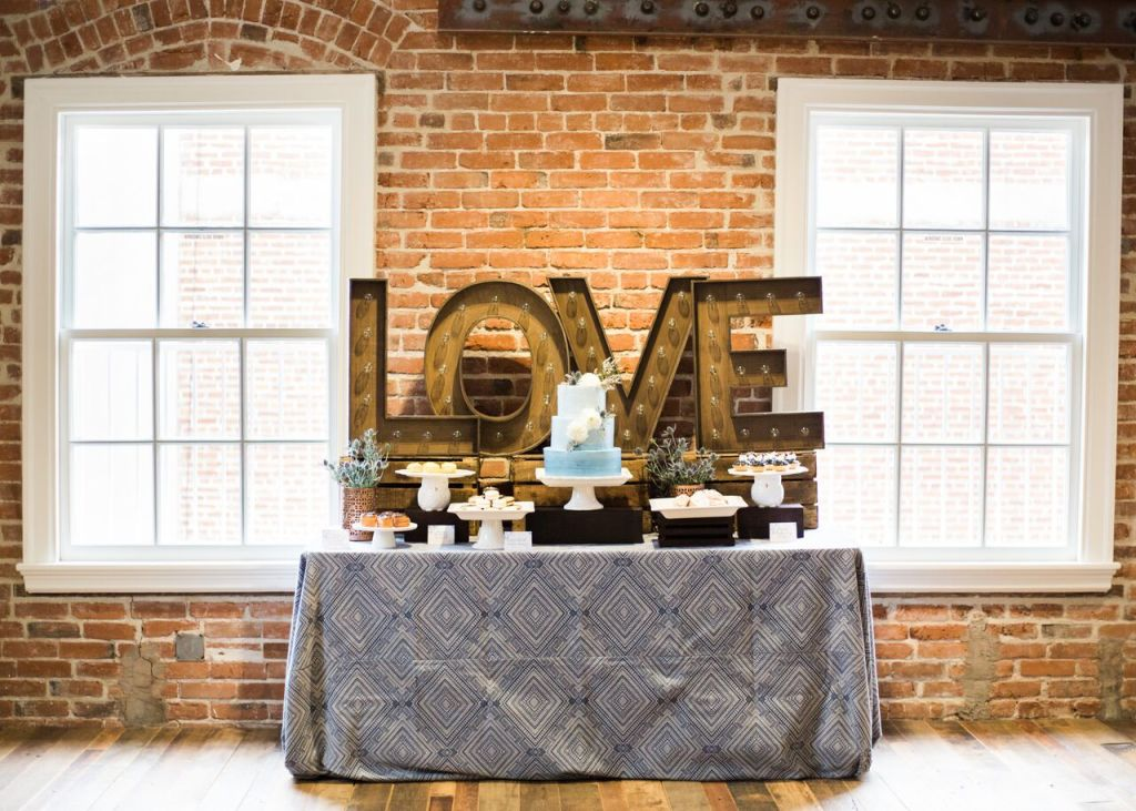 dessert-table-with-bronze-love-sign