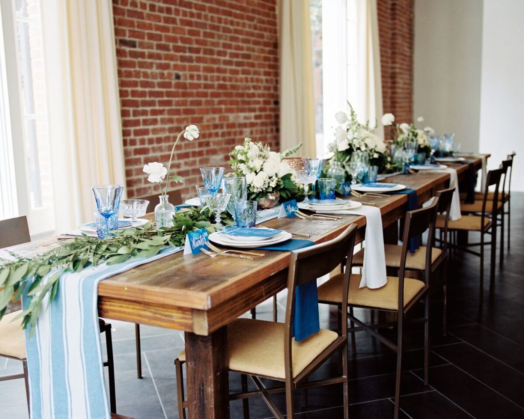 reception-table-decor-for-rustic-style-wedding-bare-wood-tables-with-greenery