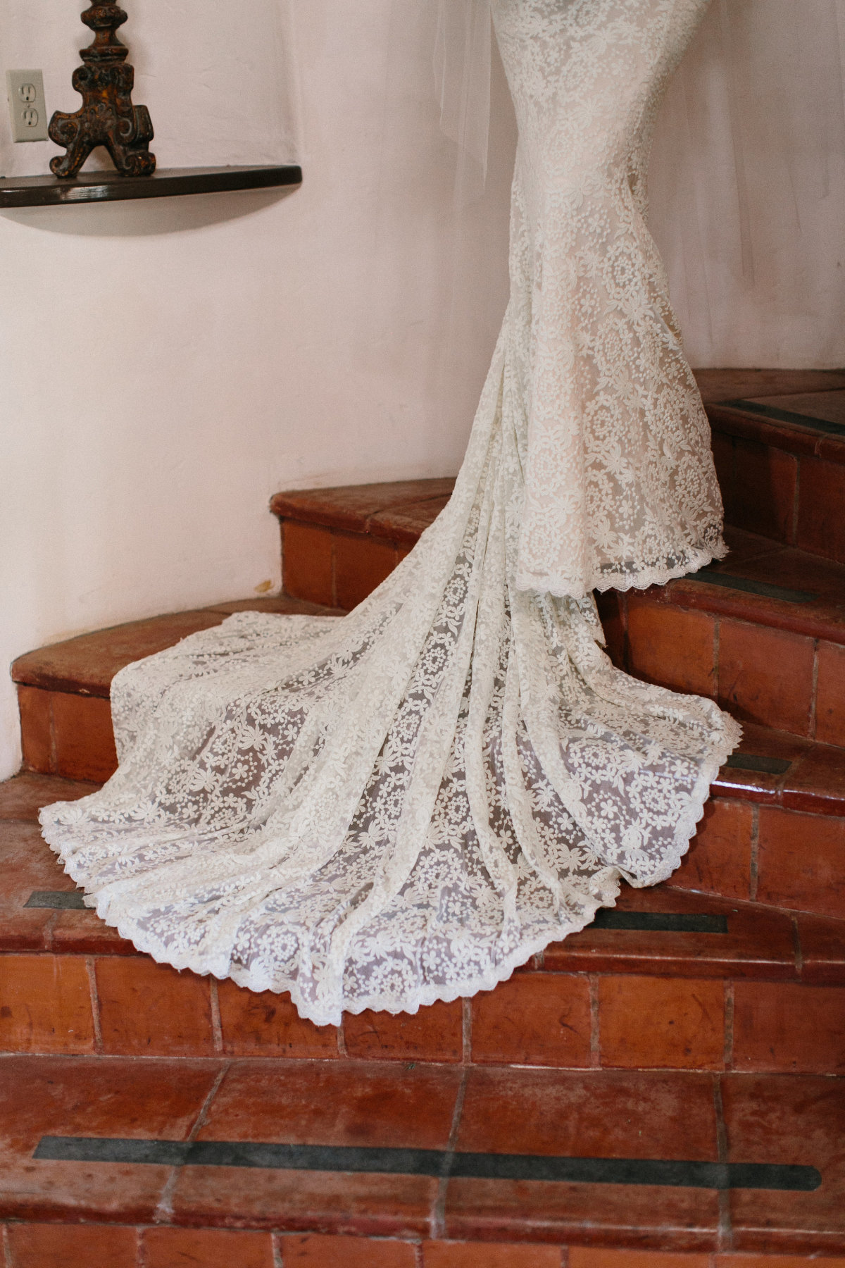 detailed-shot-of-alice-bohemian-backless-gown-against-tiled-stairs-rustic-beauty