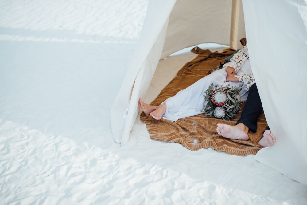 bohemian-bride-and-groom-in-teepee-in-whitesands-national-park