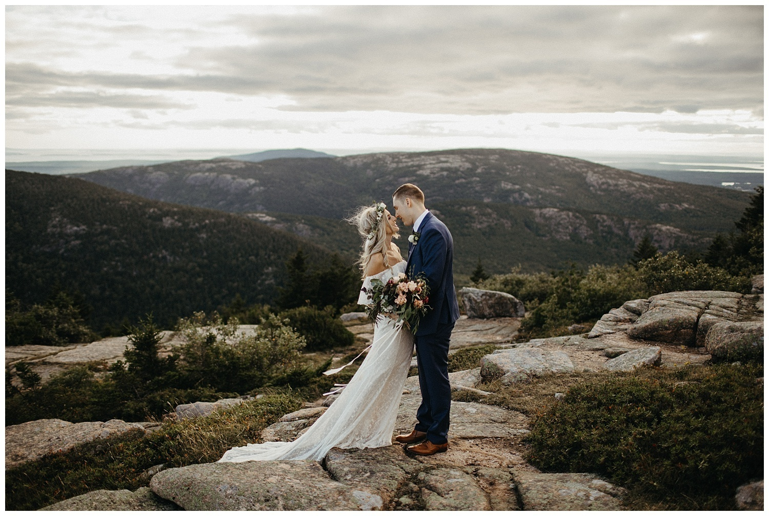 Boho-wedding-at-acadia-national-park-bride-wearing-off-the-shoulder-lace-gown