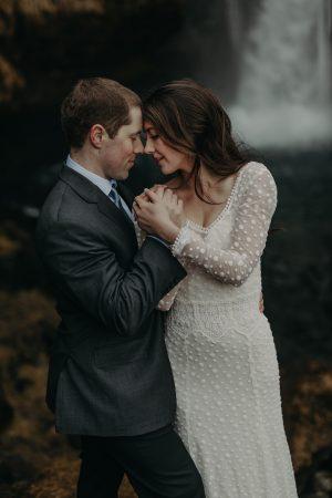 Bride-Noel's-Elopement-in-Iceland-wearing-dotted-boho-wedding-dress