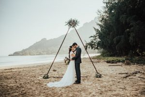 bride-wearing-dreamers-and-lovers-catherine-dress-with-train-hawaii-beach-weddings