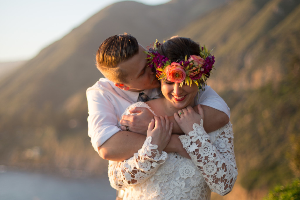 happy-boho-bride-and-groom-she-wears-a-vibrant-flower-crown-and-crochet-long-sleeve-wedding-dress