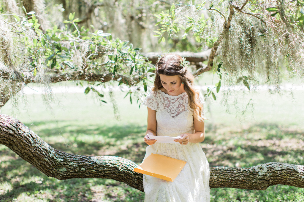 boho-bliss-Florida-wedding-boho-bride-reading-a-love-letter