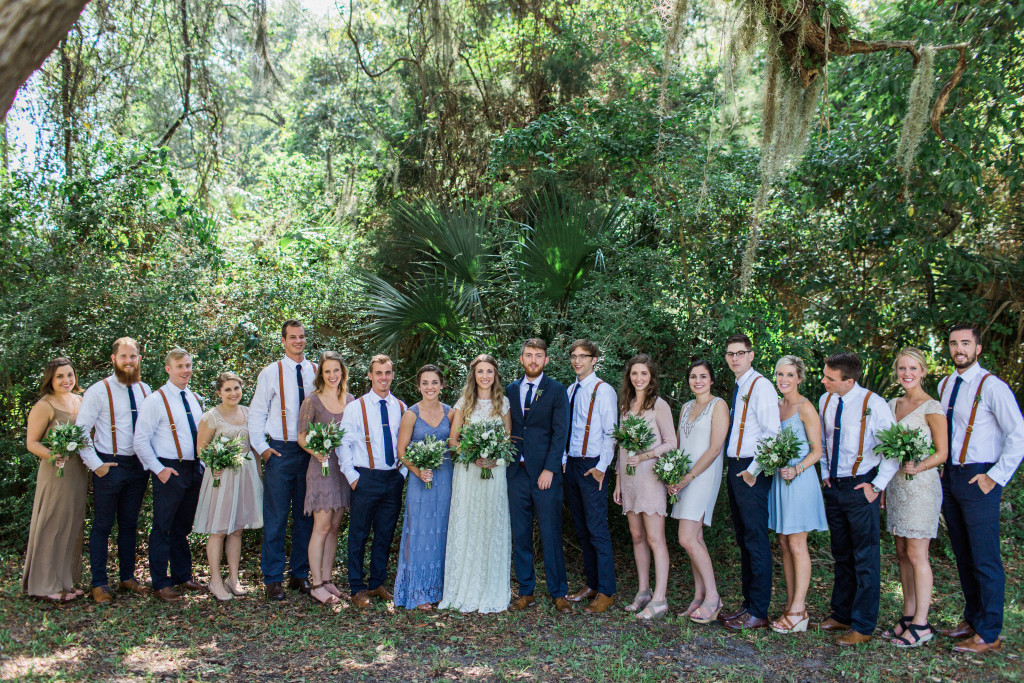 Florida-bohemian-wedding-bridal-party-and-bridesmaids-wearing-mismatched-boho-bridesmaids-dresses