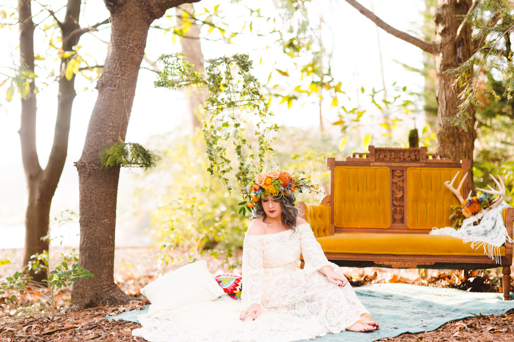 boho-bride-wearing-a-colorful-flower-crown-and-a-bell-sleeve-hippie-lace-dress