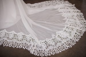 close-up-of-daisy-crochet-trimmed-silk-skirt