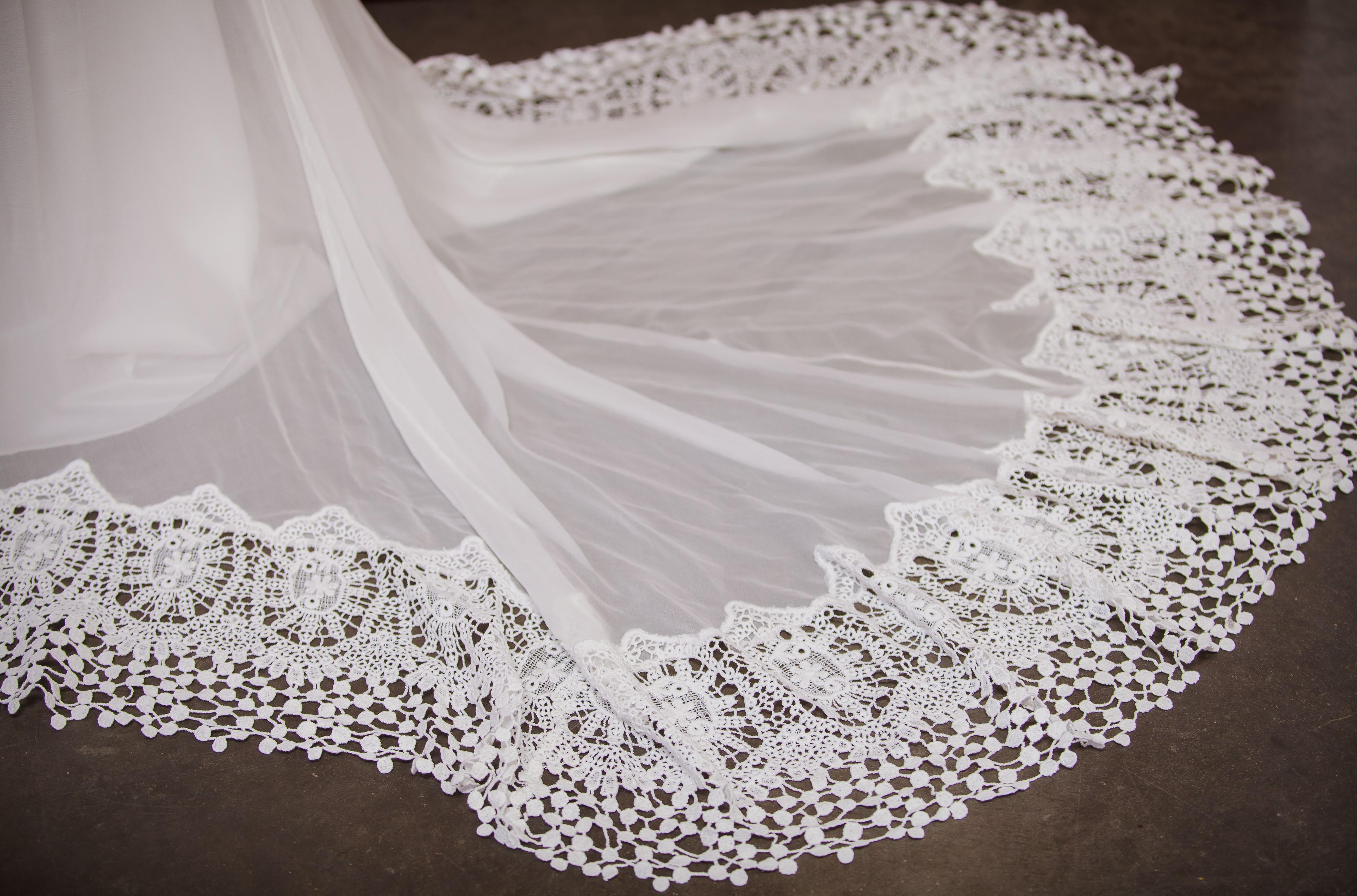 close-up-of-daisy-crochet-trimmed-silk-skirt