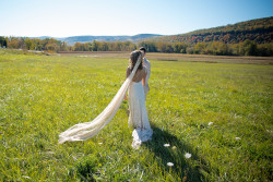 a-boho-bride-in-a-dreamy-field-wearing-a-vintage-style-wedding-dress