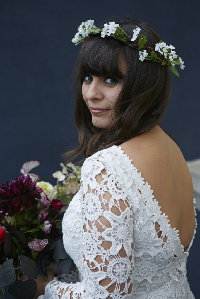 bohemian-bride-emily-wearing-backless-crochet-lace-gown-with-lush-florals-and-crown