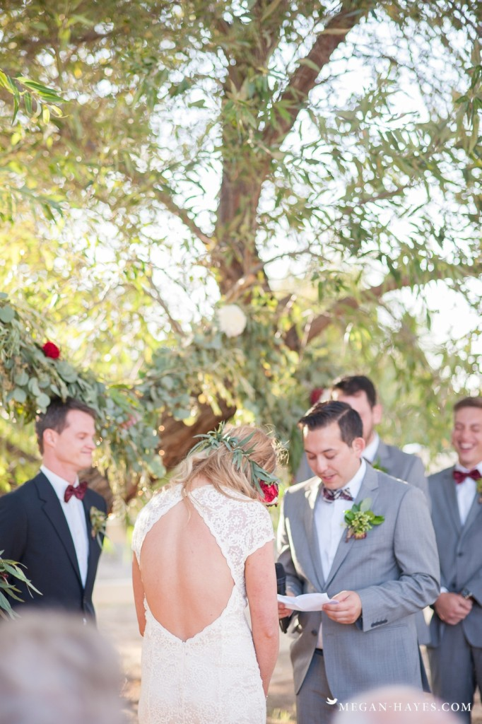 the-reading-of-the-vows-by-the-groom-in-a-dreamy-cherry-ranch-boho-wedding