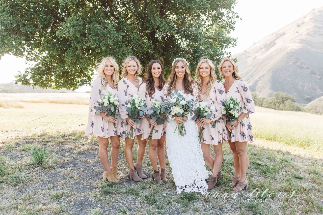 a-boho-wedding-at-a-rustic-farmhouse-in-california-here-with-her-bohemian-bridesmaids-in-floral-dresses