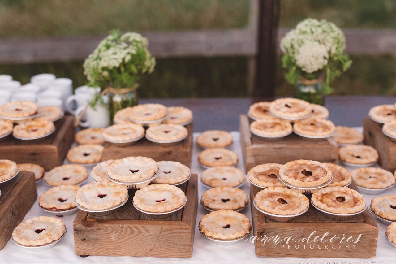 a-table-full-of-pies-at-a-farmhouse-bohemian-wedding