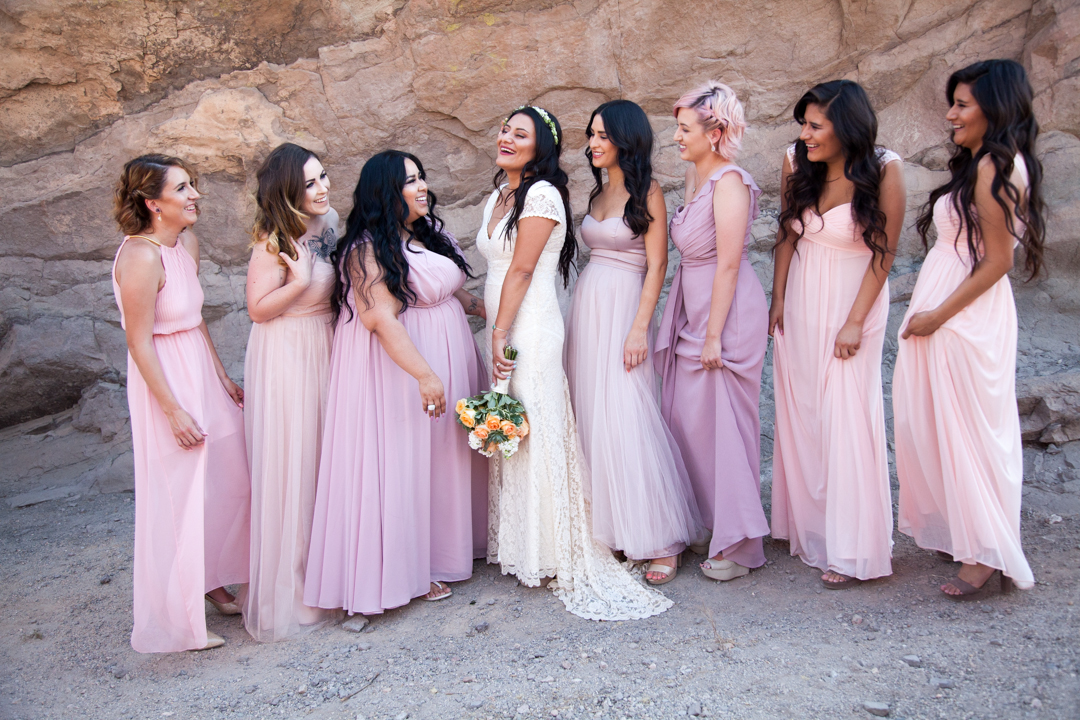 bohemian-wedding-party-bridesmaids-in-pink-dresses-bride-in-boho-lace-dress