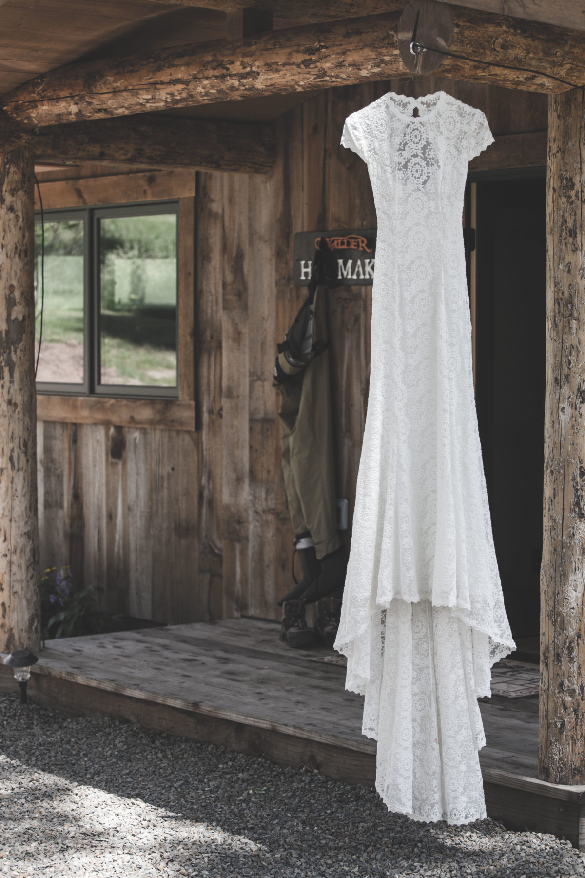 the-alice-dress-from-dreamers-and-lovers-shown-in-white-lace-with-long-train-backless-rustic