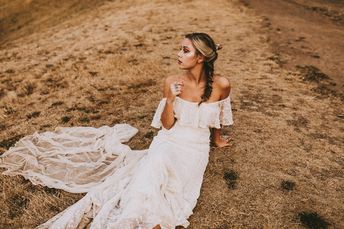bohemian-off-shoulder-lace-wedding-dress-shown-here-in-ivory