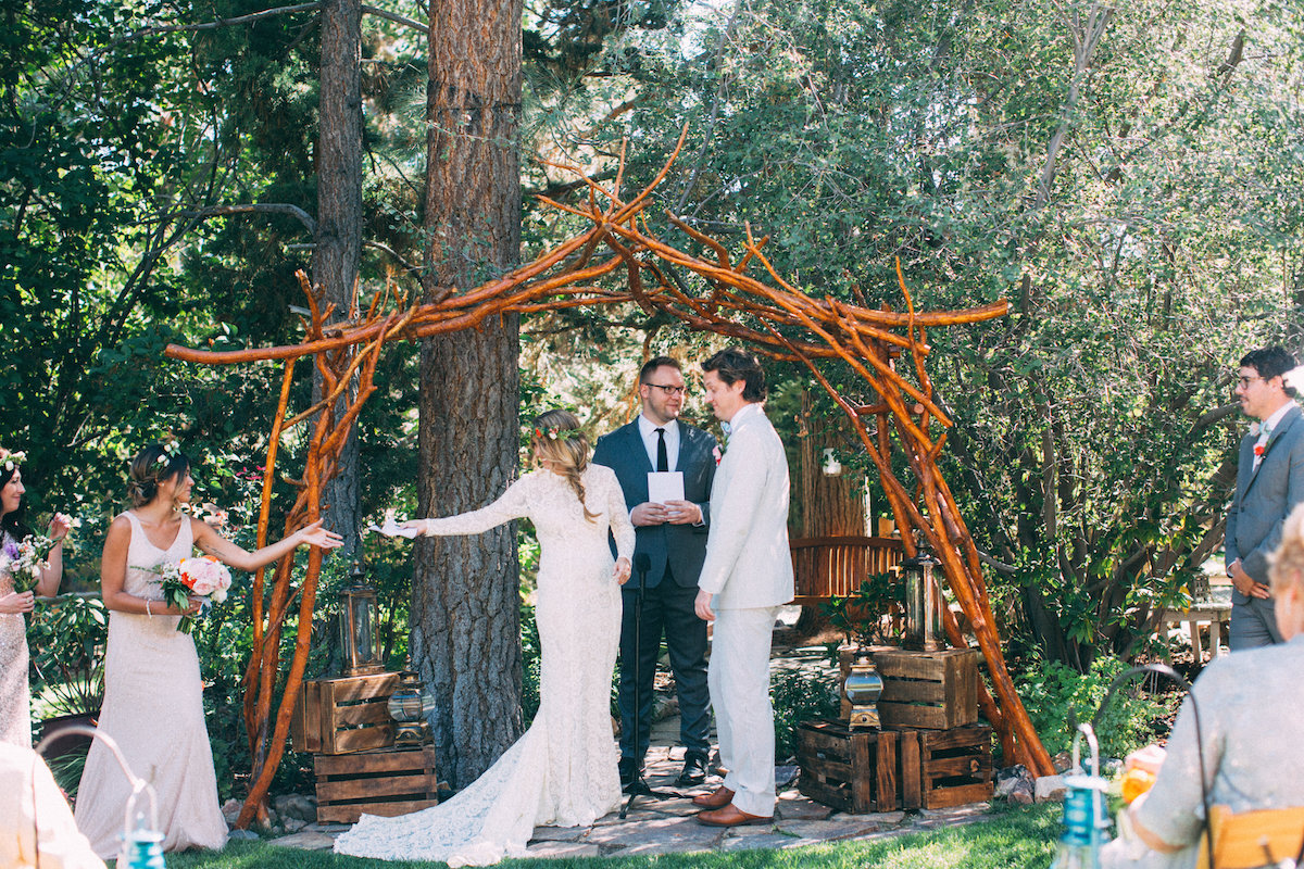 reading-at-bohemian-wedding-at-the-big-bear-lodge-bride-amy-wearing-dreamers-and-lovers-long-sleeved-wedding-dress-in-lace