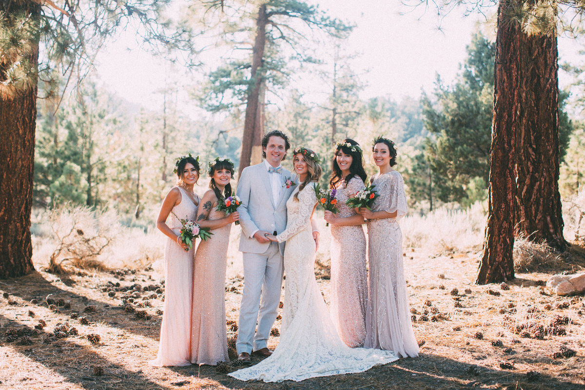 bride-and-groom-with-bridesamids-wearing-mismatched-bridesmaids-dresses-in-shades-of-blush