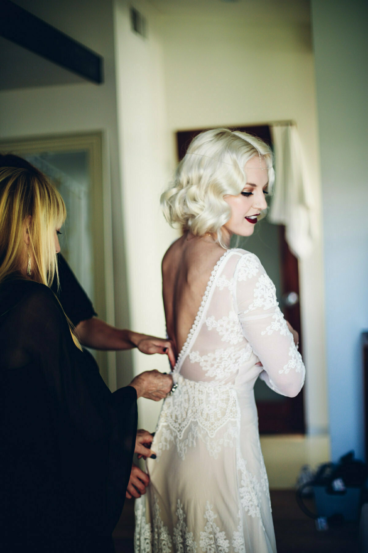 bride-chloe-wearing-backless-lace-dress-with-fitted-sleeves-dreamers-and-lovers-lisa