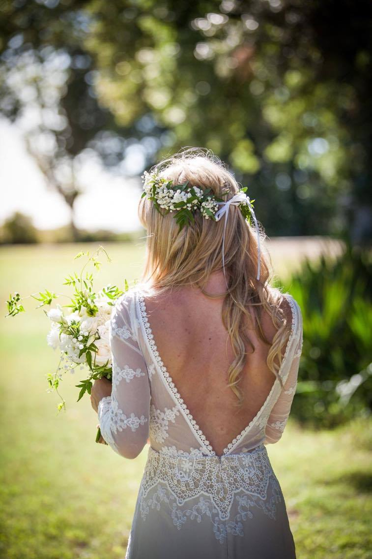 the-bride-in-a-backless-applique-lace-wedding-dress-adorned-with-long-sleeves-perfect-for-her-boho-chic-style