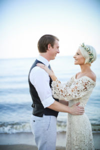 heidi-and-kyle-shares-a-tender-moment-at-their-simple-boho-beach-wedding