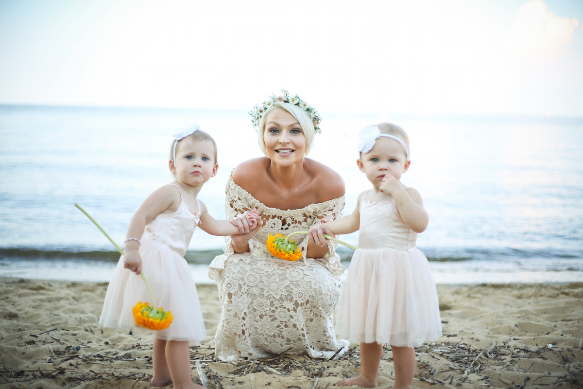 a-boho-bride-wearing-crochet-off-shoulder-lace-dress-with-her-little-flower-girls