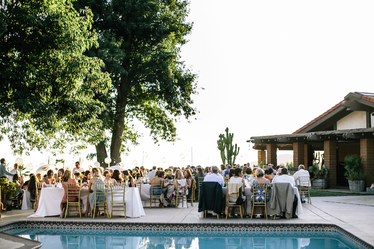 the-wedding-guests-gathered-beautifully-by-the-pool