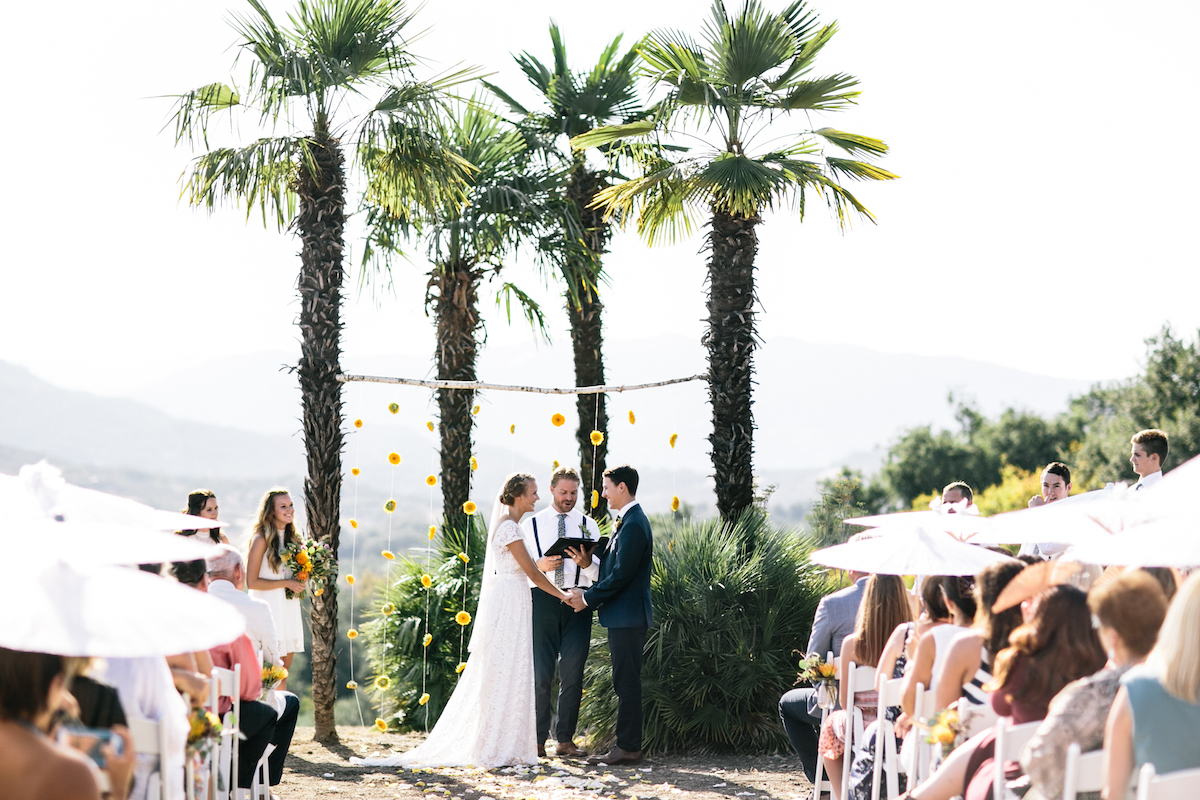 a-dreamy-bohemian-wedding-set-in-the-California-sunshine-the-bride-and-groom-at-the-altar