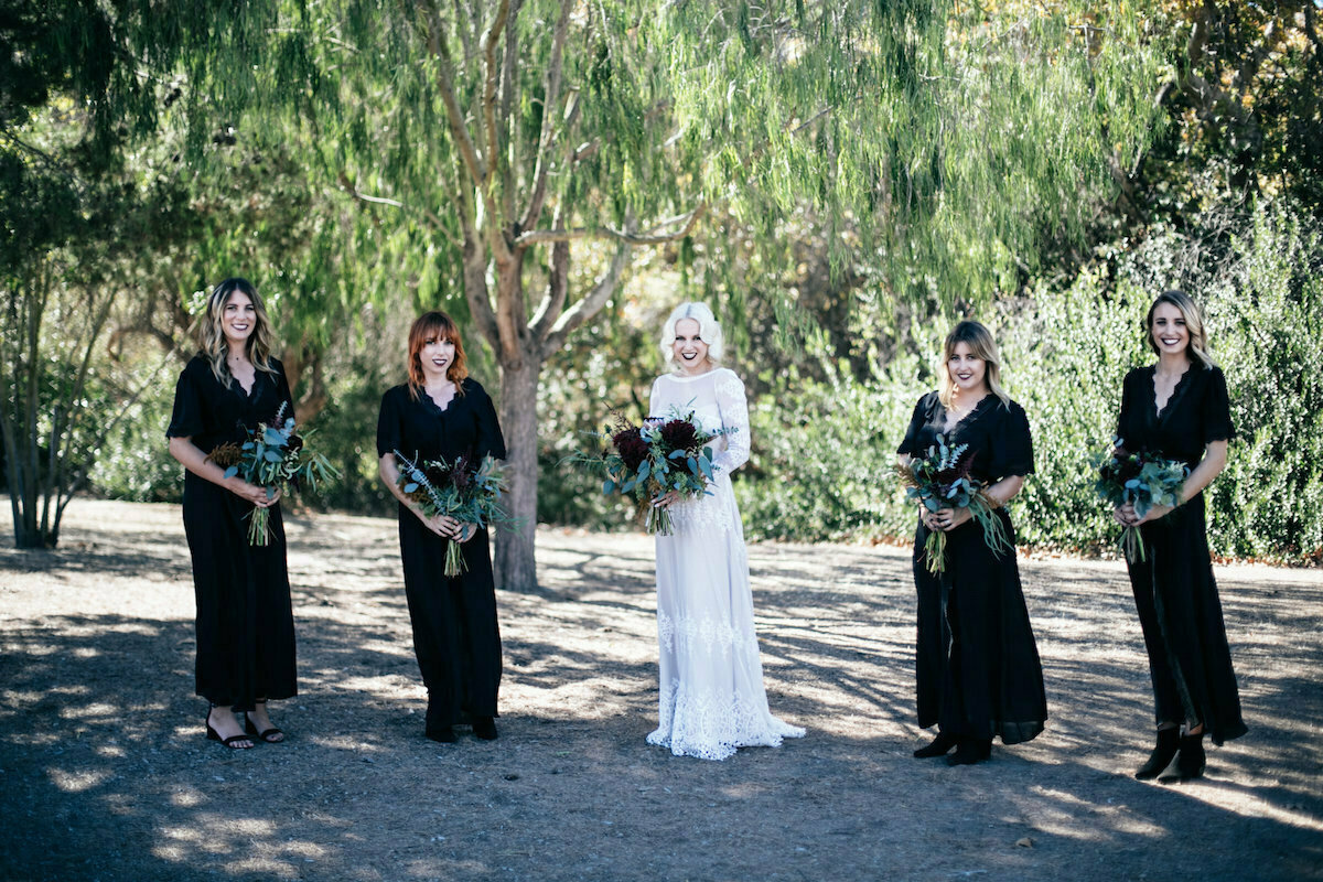 bridesmaids-wearing-mismatched-black-dresses-bohemian-wedding-inspiration