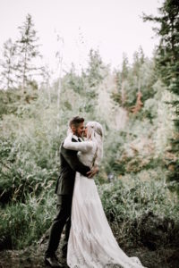 Lizzy-and-Dan-love-story-her-wearing-the-Lisa-long-sleeve-lace-wedding-dress-with-a-boho-braid-in-her-hair-for-her-rustic-ceremony