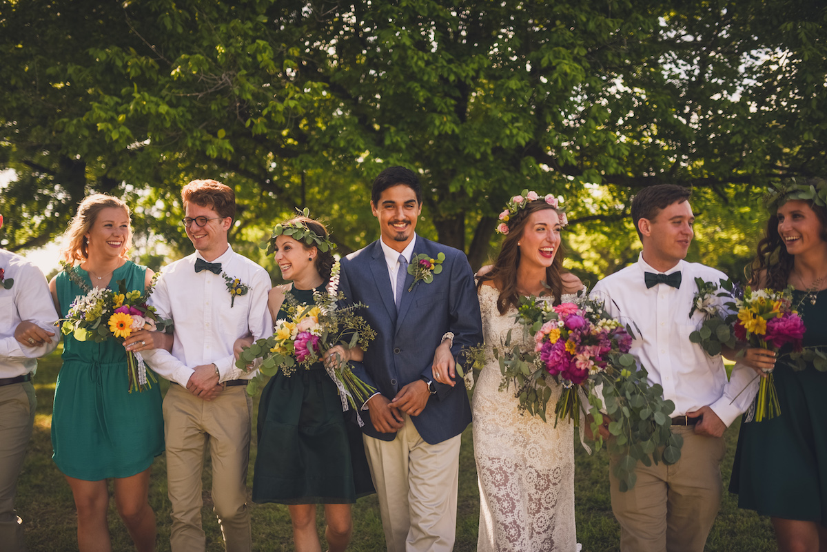 the-happy-bride-groom-and-bridal-party-shares-laughs-in-this-Oklahoma-bohemian-wedding
