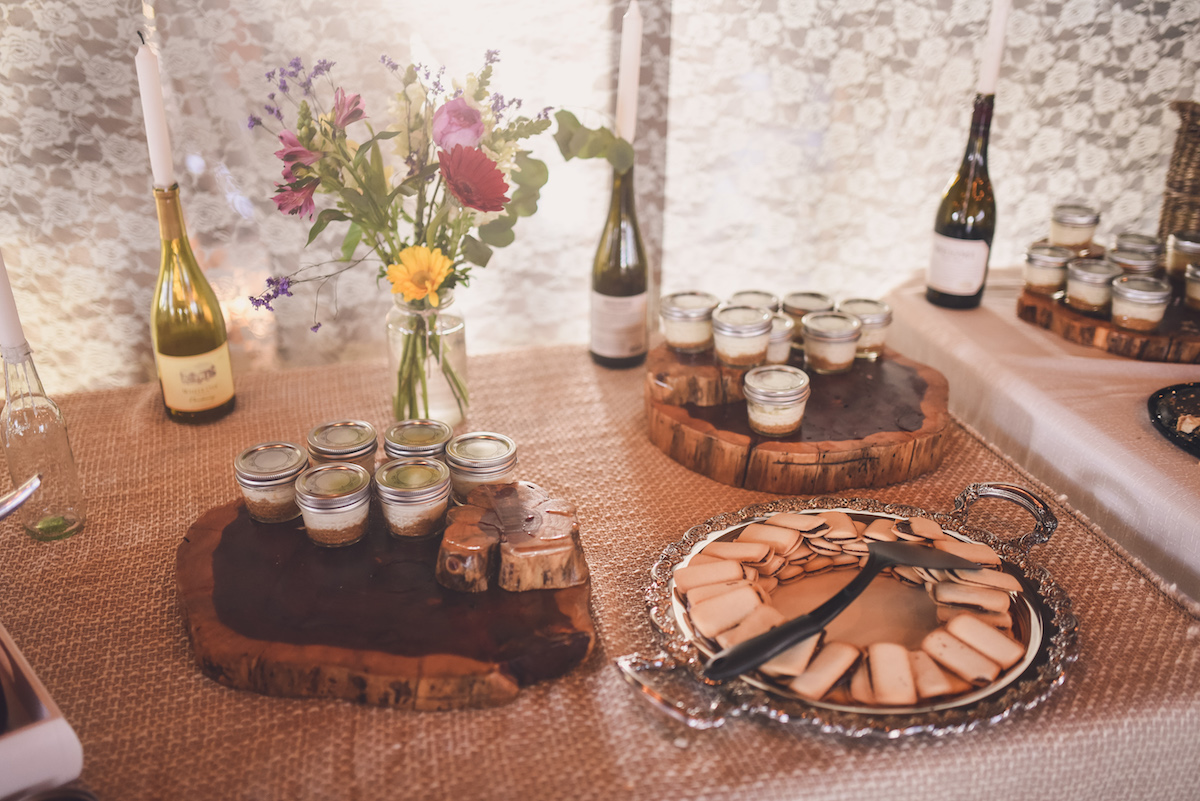 the-dessert-table-filled-with-cupcakes-pies-and-wild-flowers-boho-wedding-inspo