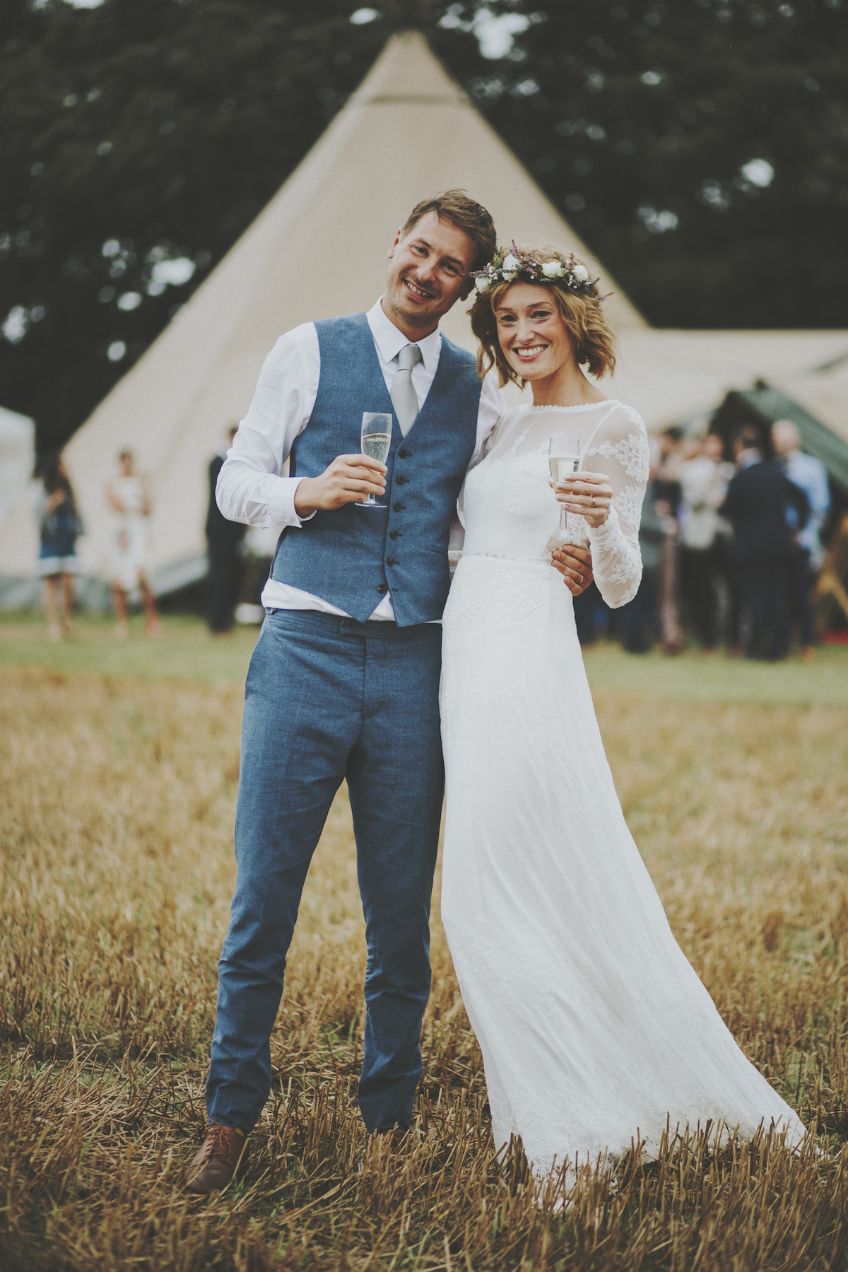 an-English-bride-in-a-simple-long-eleeve-backless-wedding-dress-and-the-groom-in-a-two-piece-blue-suit