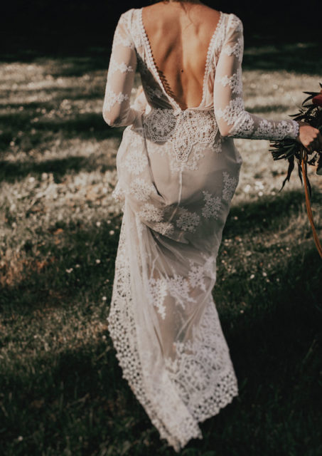 a-boho-wedding-dress-with-backless-and-long-sheer-sleeves-for-the-bohemian-bride