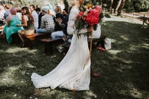 bride-Olga-walking-down-the-aisle-in-the-now-iconic-dreamers-and-lovers-Lisa-dress