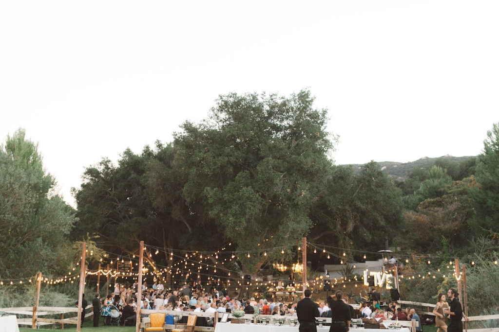 string-llghts-draped-from-trees-at-this-relaxed-vibe-ranch-wedding