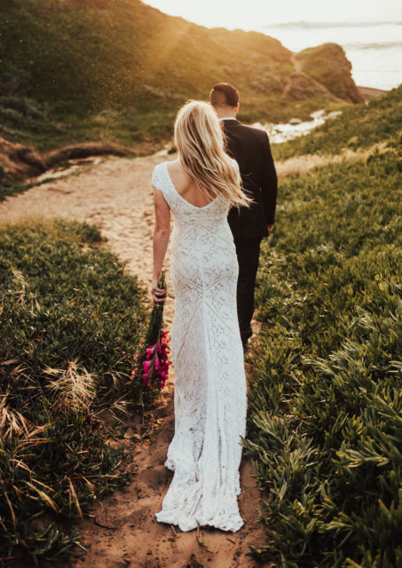 bride-wearing-white-lace-adelaide-dress-with-long-train