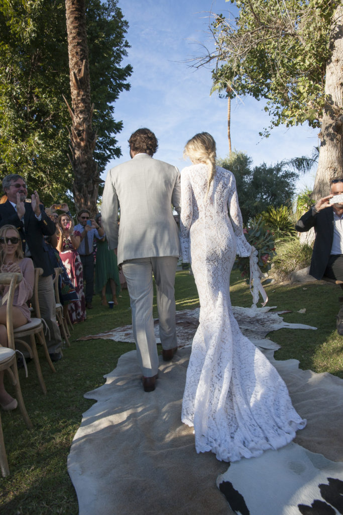 what-a-boho-bride-looks-like-when-she-wants-to-be-effortless-but-still-classic-she-wears-a-simple-all-lace-gown-with-long-bell-sleeves