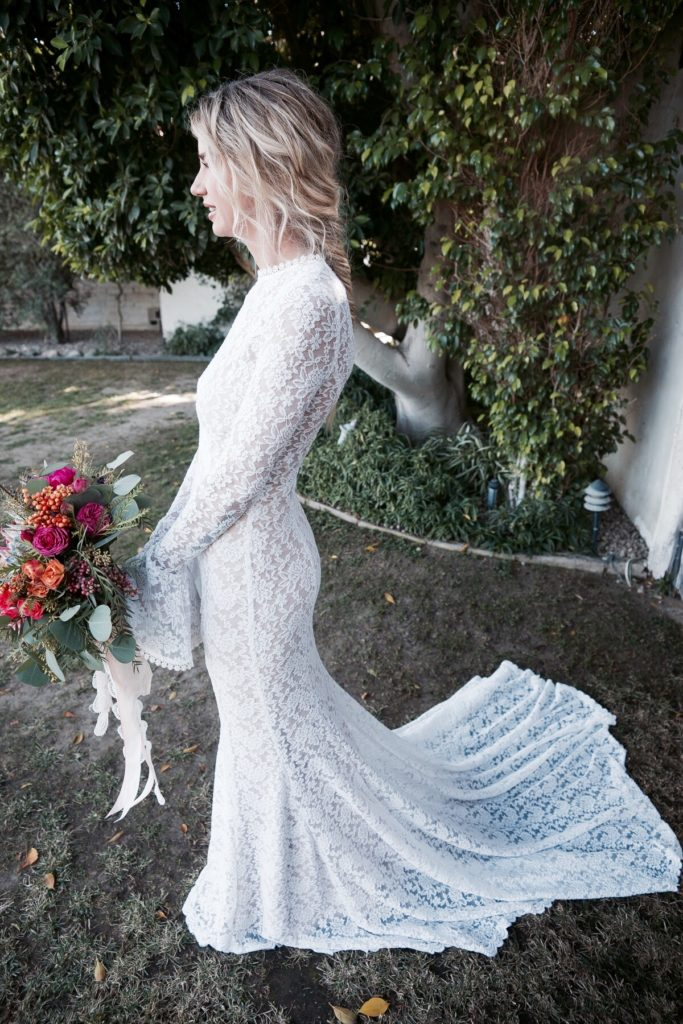bride-jennie-in-dreamers-and-lovers-long-bell-sleeve-simple-wedding-dress-in-white-lace-with-nude-liner