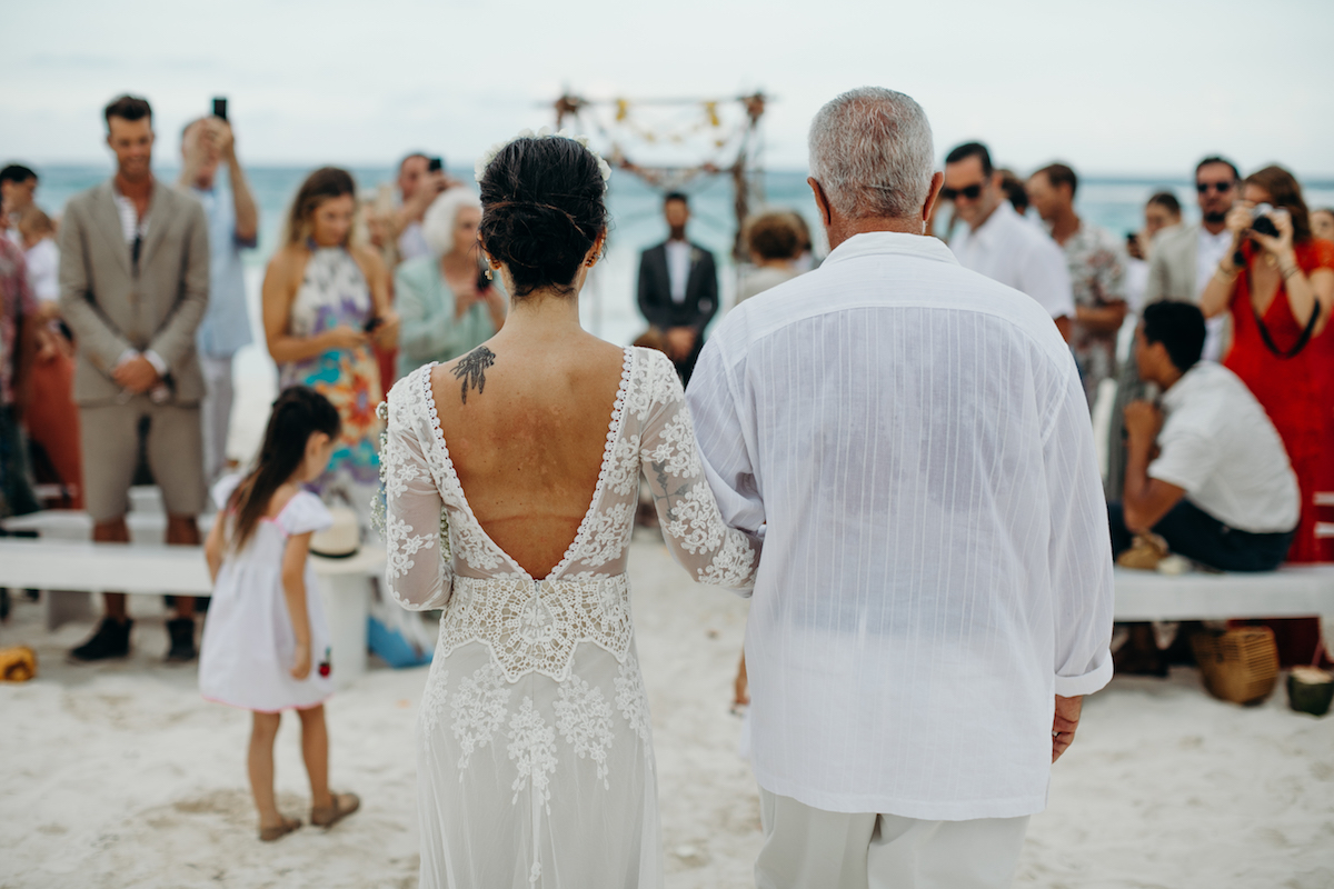 the-bride-walks-down-the-aisle-in-her-long-sleeve-lisa-boho-wedding-lace-dress