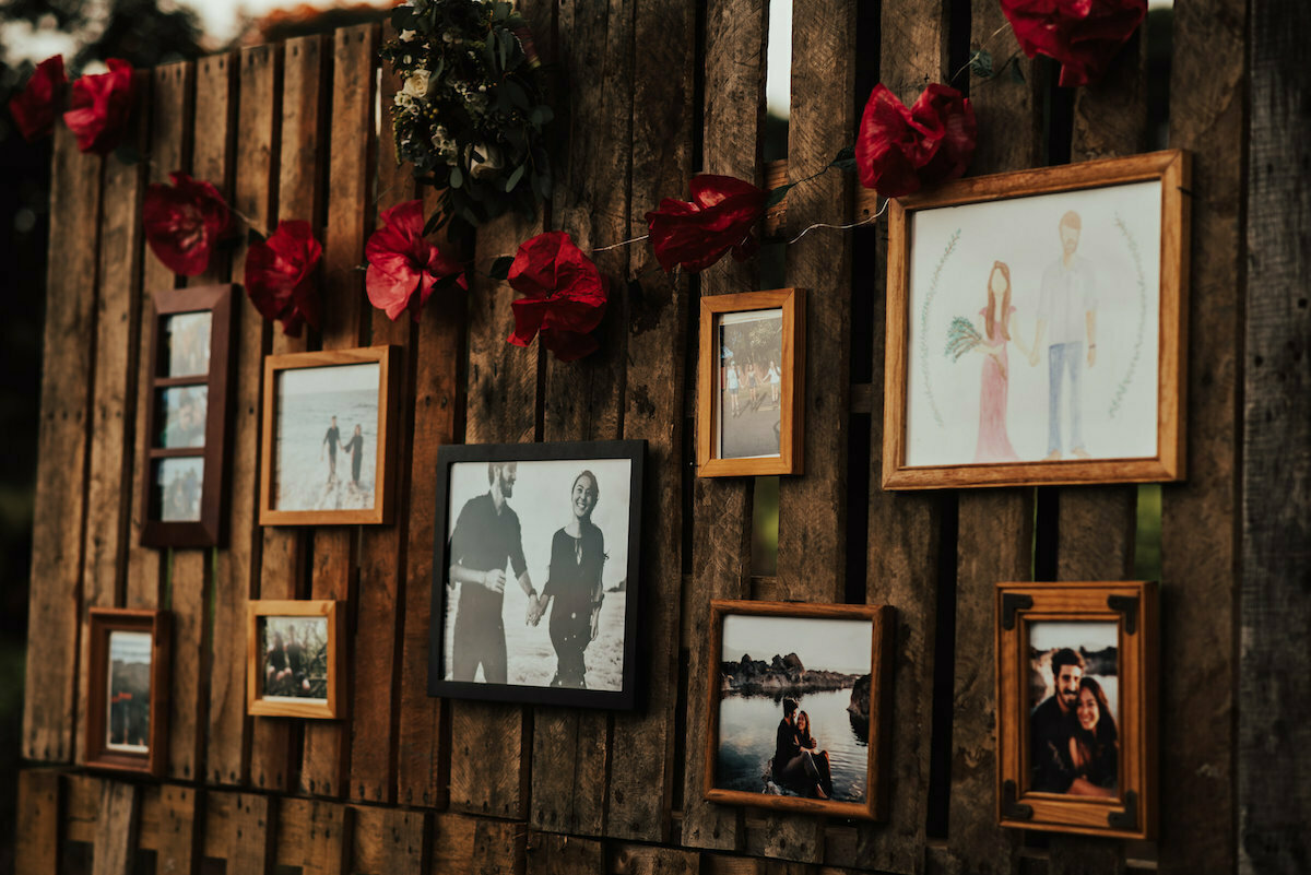 photos-of-the-couple-on-a-rustic-wooden-wall-bohemian-wedding-decor